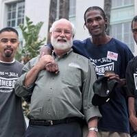 """Father Greg Boyle takes a picture with Homeboy Industries participants. 