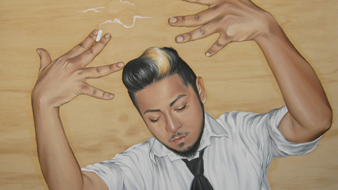 A young man holds his hands up in a portrait drawn on wood by Shizu Saldamando.