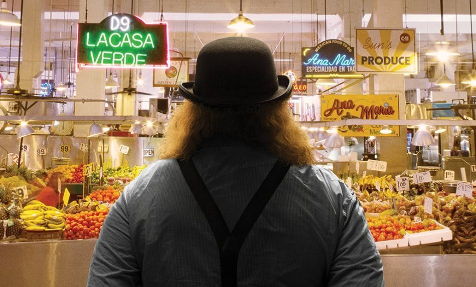 "Jonathan Gold at Grand Central Market in Los Angeles | Image from the film ""City of Gold"""