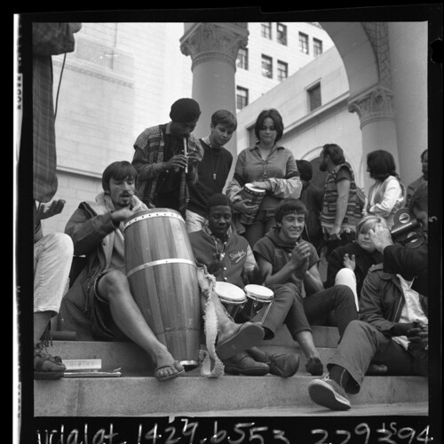 Group of ''Venice bohemians'' playing bongos on steps of Los Angeles City Hall to protest city ordinance, 1965   Los Angeles Times photographic archive/UCLA Library/Creative Commons