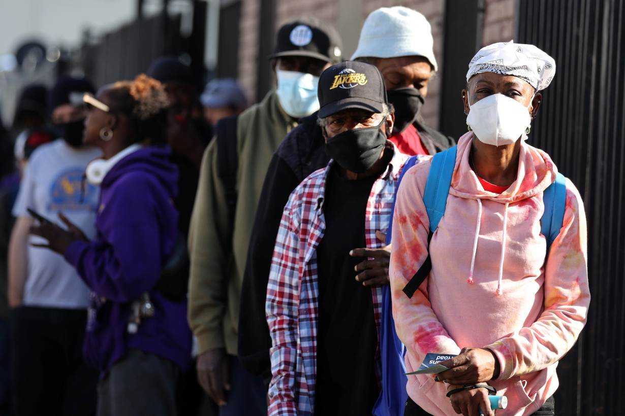 People wait in line for a Los Angeles Mission homeless shelter Thanksgiving meal giveaway, as the global outbreak of the coronavirus disease (COVID-19) continues, in Los Angeles, California, U.S., November 25, 2020.