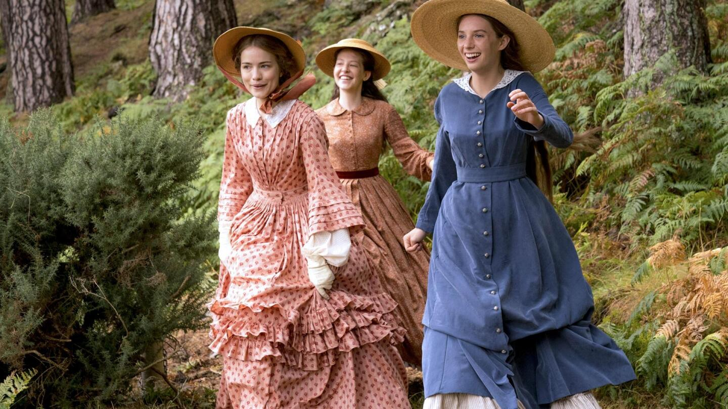 "Three March sisters run through a forest. | From ""Little Women on Masterpiece"""