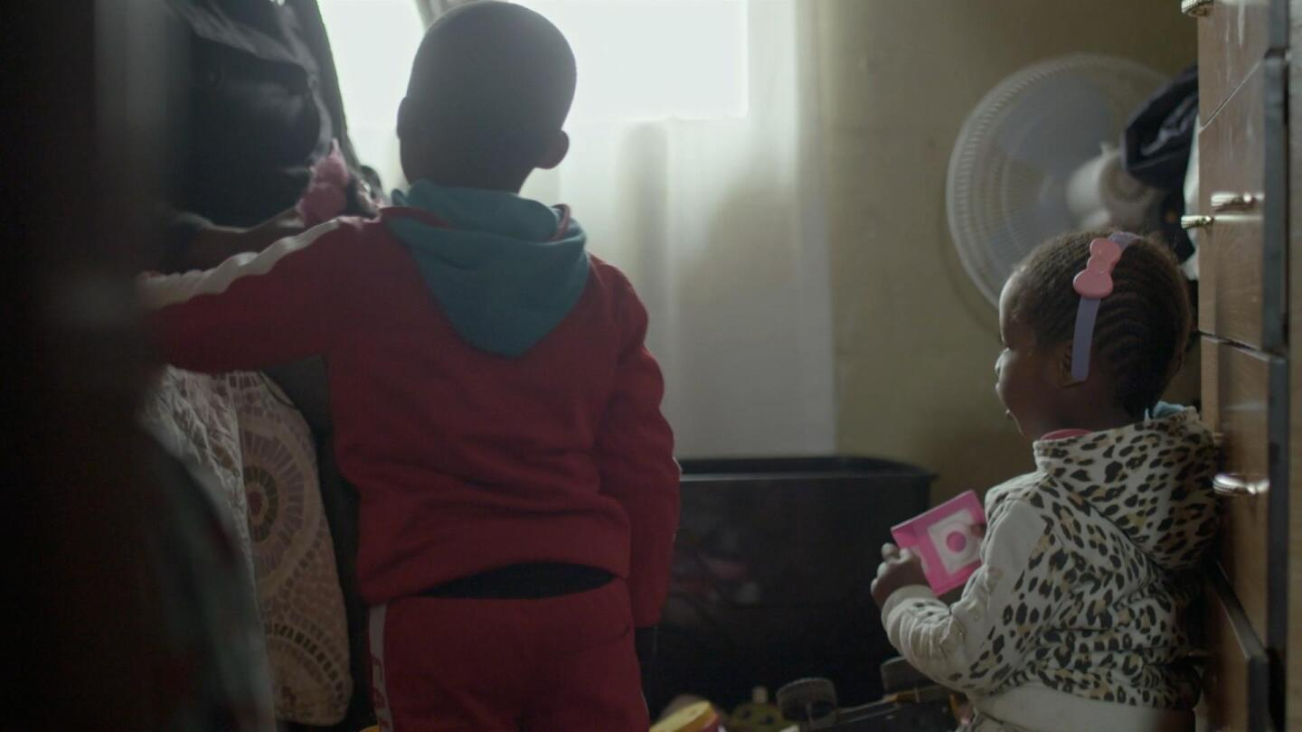 "Two young children suffer respiratory illnesses caused by coal mining in South Africa. | Still from ""Earth Focus"""