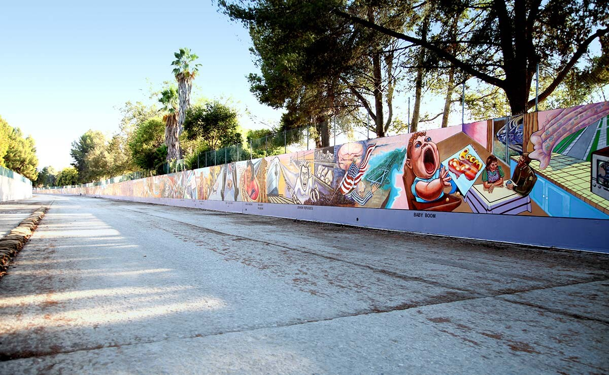 """A view of the 13' x 2,400' """"Great Wall"""" mural located in the Tujunga Wash, a flood control channel. It depicts a multi-cultural history of California from prehistory through to the 1950s."""