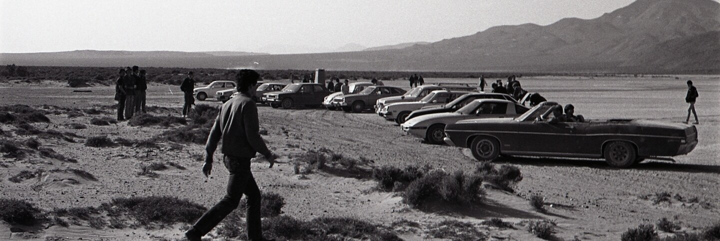 Parked cars, Desolation Center: Mojave Exodus, 1983 | Dan Voznick
