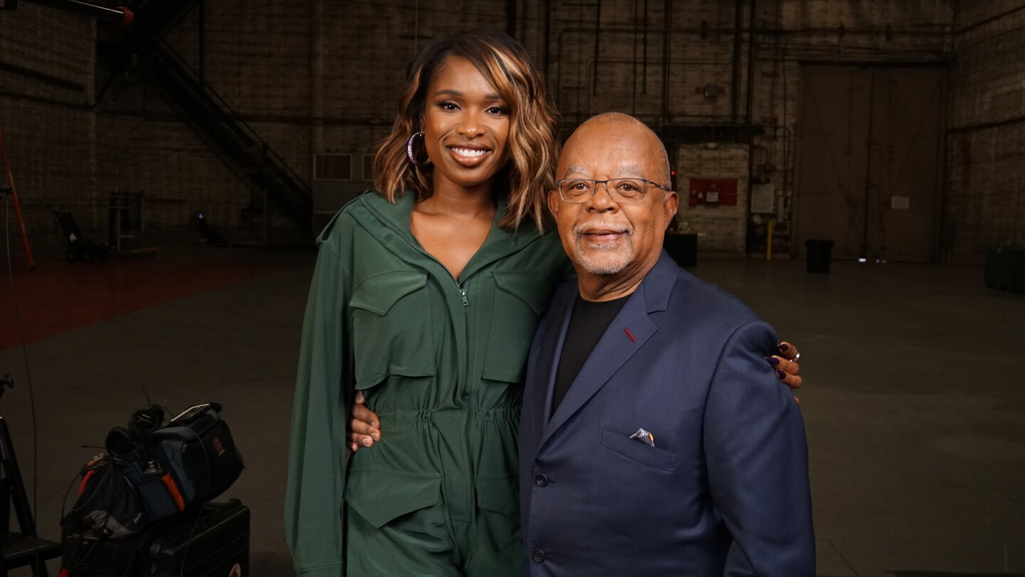 Jennifer Hudson and Henry Louis Gates, Jr. pose for a picture together.