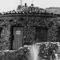 """The former home of architect R. Lee Miller. The sign on the door says: """"Shanti. Enter with Primitive Bare Feet.""""   Courtesy of Palm Springs Historical Society. All Rights Reserved."""