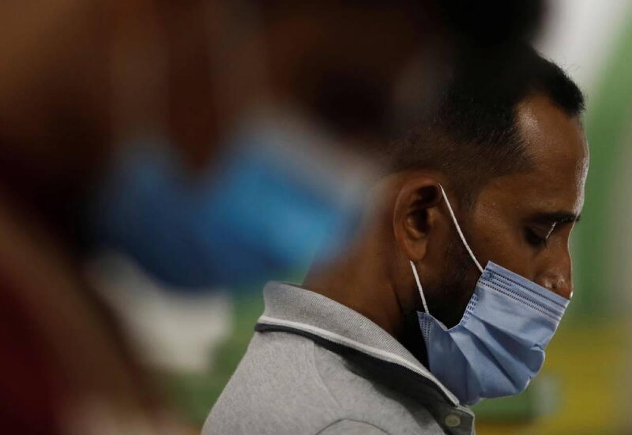 Muslims wearing face masks as precaution against the coronavirus disease (COVID-19), attend Ramadan Tarawih prayers at Sultan Mosque in Singapore, April 13, 2021.