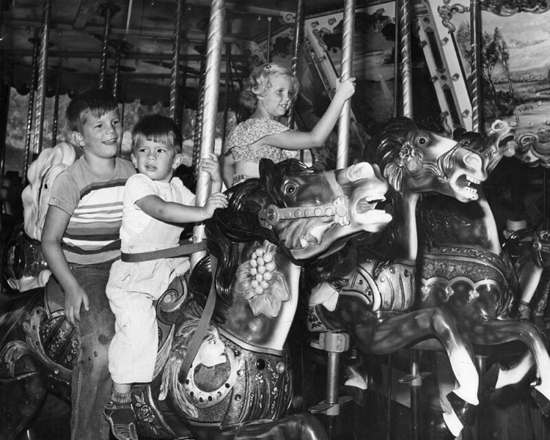 Two boys on the Griffith Park Merry-Go-Round| Dean Musgrove, Herald Examiner Collection, Los Angeles Public Library