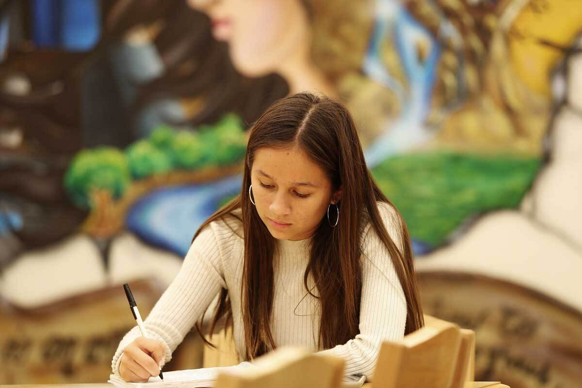 A child writing | Courtesy of Think Together