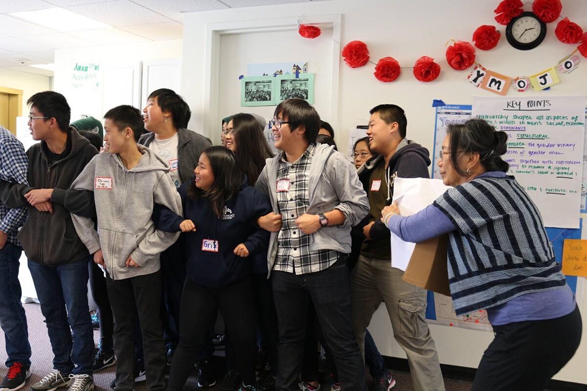 Pam Tau Lee with YouthMOJO members at Chinese Progressive Association, circa 2014 | Chinese Progressive Association