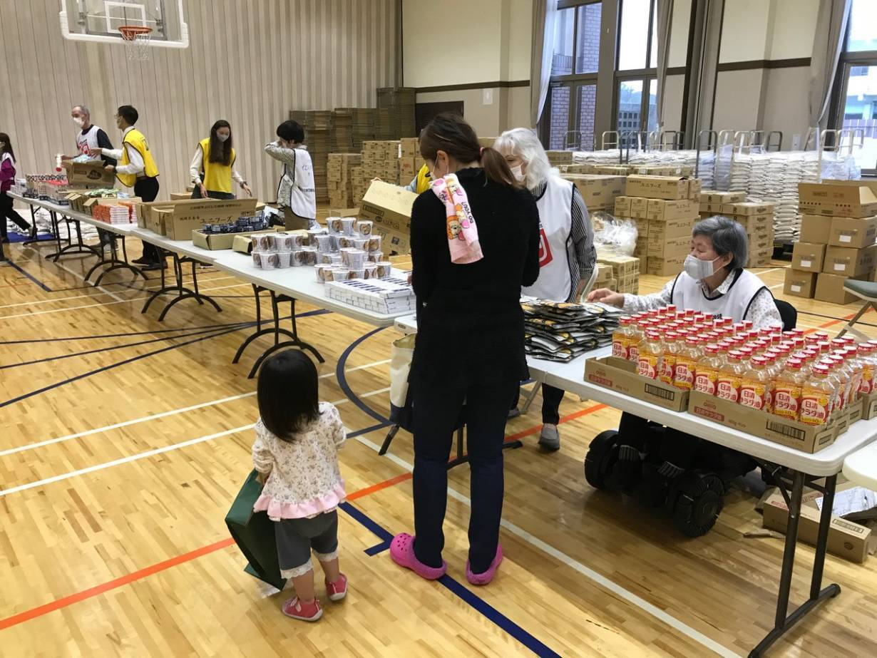 Volunteers handle food donations in Tokyo, Japan