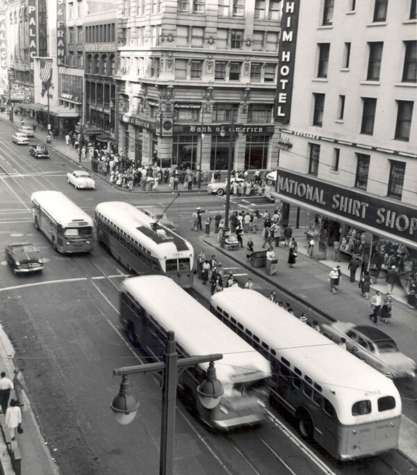 Seventh and Broadway circa 1956. Buses and streetcars share the road with pedestrians and automobiles. Courtesy of the Metro Transportation Library and Archive. Used under a Creative Commons license.