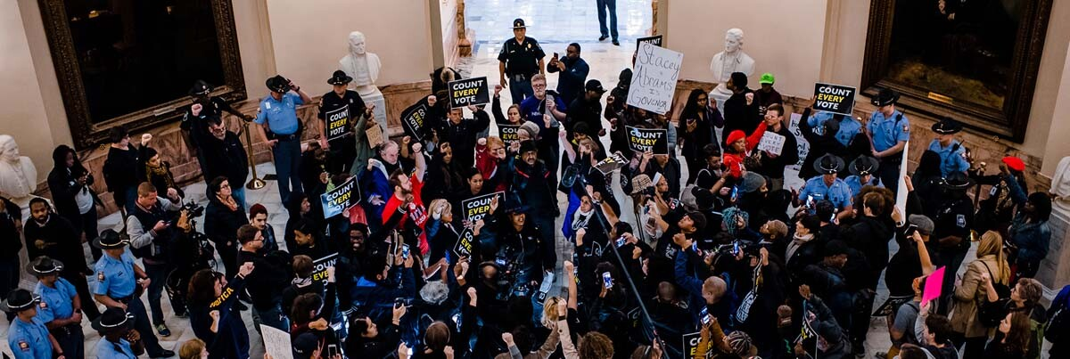 A crowd gathers in the rotunda of the Georgia State Capitol for the Count Every Vote protest in Atlanta, in 2018. | Kevin Lowery