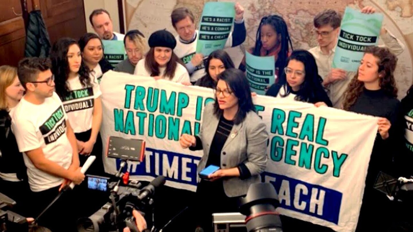 """Demonstrators calling for impeachment of Trump. 