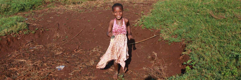Child playing in Bukaleba Forest Reserve, Uganda