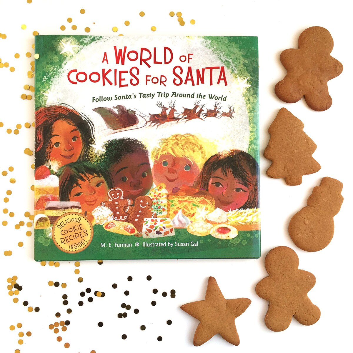 """Book cover of """"A World of Cookies for Santa"""" written by M.E. Furman and illustrated by Susan Gal surrounded by brown holiday cookies."""