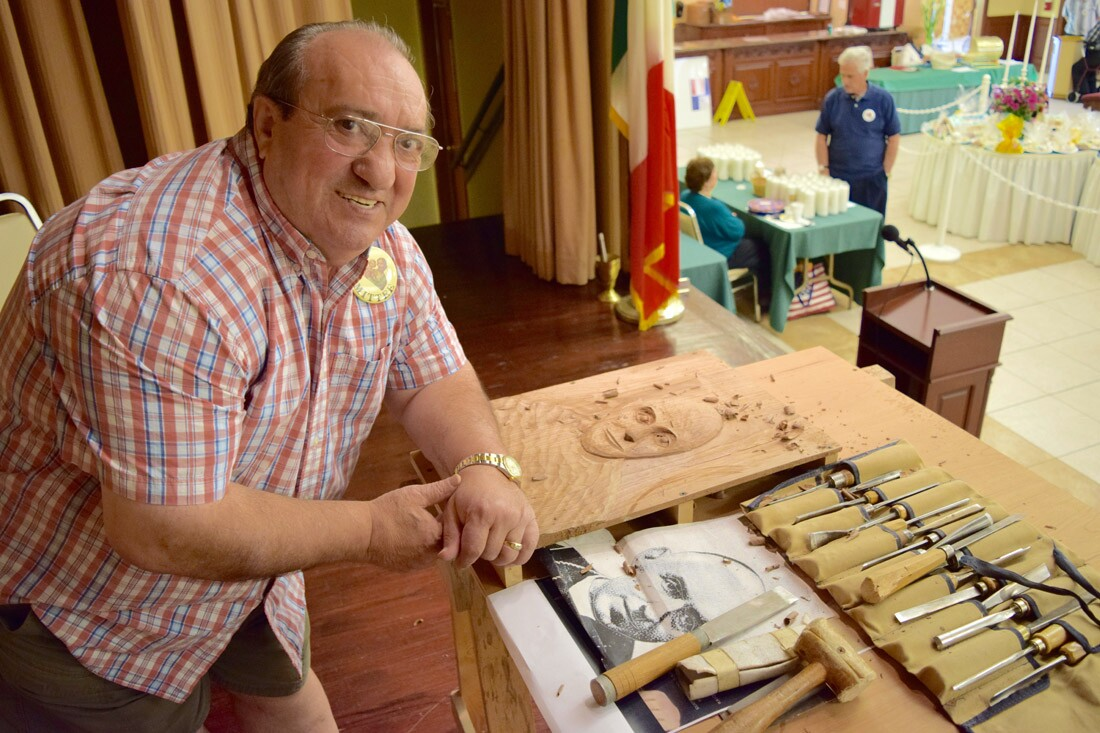 Pasquale Bruno, a committee member for St. Joseph's Day, carves a portrait of Italian Bishop Giovanni Battista Scalabrini.