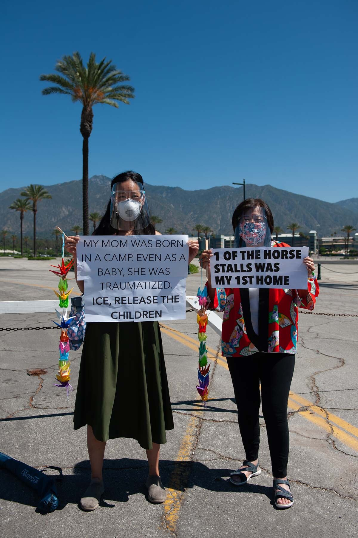 Two women in protest at the Santa Anita Assembly Center | William Camargo, In Plain Sight