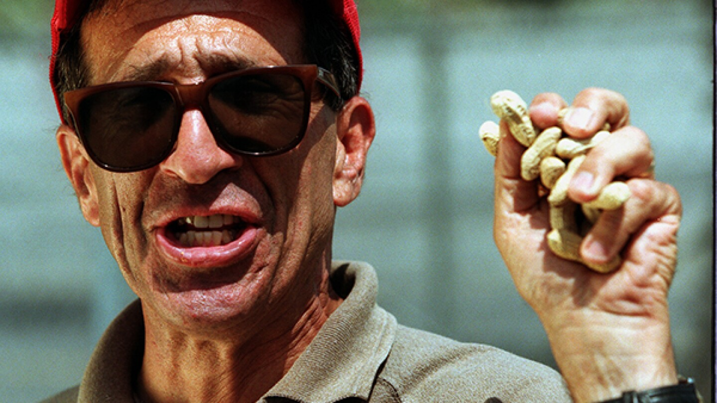 Richard Aller, peanut vendor, holds a fistful of roasted nuts   Photo by Kirk McKoy/Los Angeles Times via Getty Images