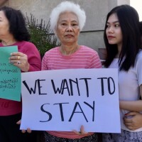 Dieu Pham, 70, takes part in an anti-eviction protest outside her apartment building in August 2019. A new owner is trying to evict the tenants now. | Josie Huang/LAist