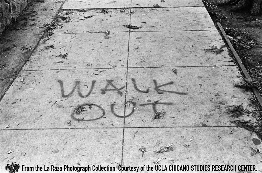 """CSRC_LaRaza_B1F3C4_DW_025 """"Walkout"""" sprayed on the sidewalk during the Roosevelt High School walkout 