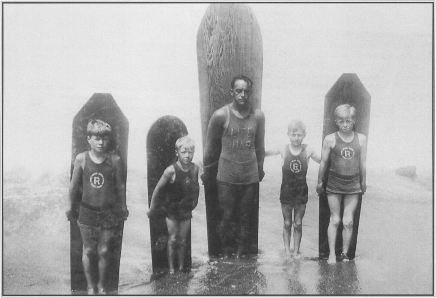 Teaching and coaching youngsters in swimming, surfing, and water safety may have been Freeth's greatest delight. Lined up with their boards in the surf at Redondo Beach, these local boys grew up to become the nuclei of modern ocean lifesaving crews.