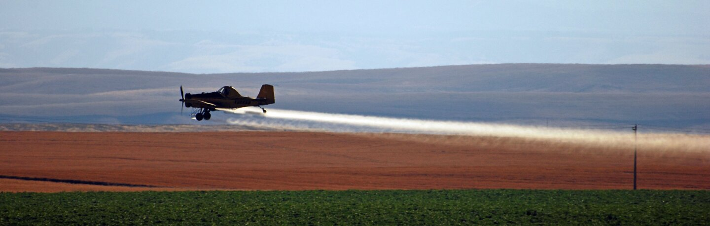 A crop duster at work | Photo: Scott Butner, some rights reserved