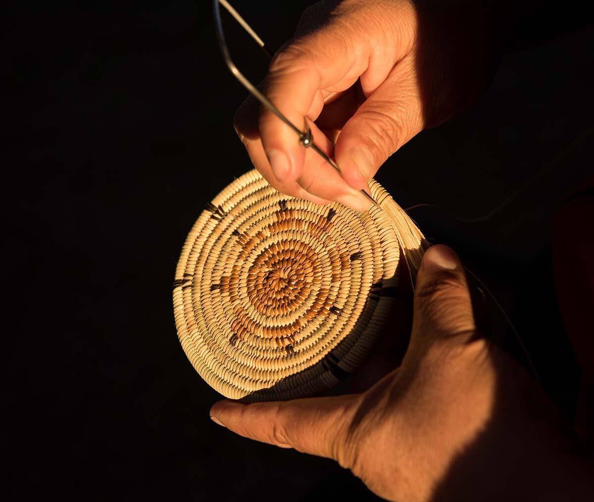 Maria de los Angeles Carillo using an awl | Rose Ramirez