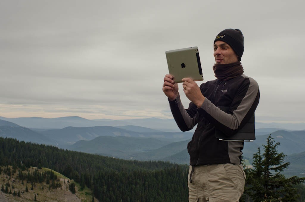 Parks and Technology hiker with ipad