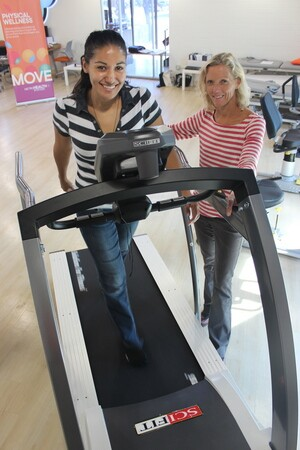 MHS's director of physical therapy, Anita Correa, MPT, assisting a patient on the treadmill