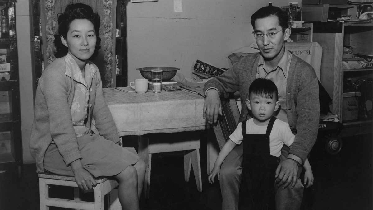 Henry and Ayako Tsurutani seated at the kitchen table in their Manzanar barracks with their son, Bruce, on his 3rd birthday   Ansel Adams