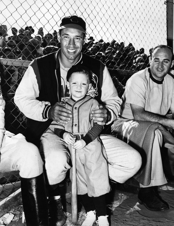 A child poses with Cleveland Indians pitcher Bob Feller at Burbank's Olive Memorial Stadium in 1949. Courtesy of the Herald-Examiner Collection, Los Angeles Public Library.
