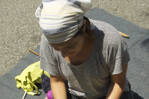 Tanya Aguiñiga backstrap weaving in Beverly Hills. | Photo: Nicole Levy.