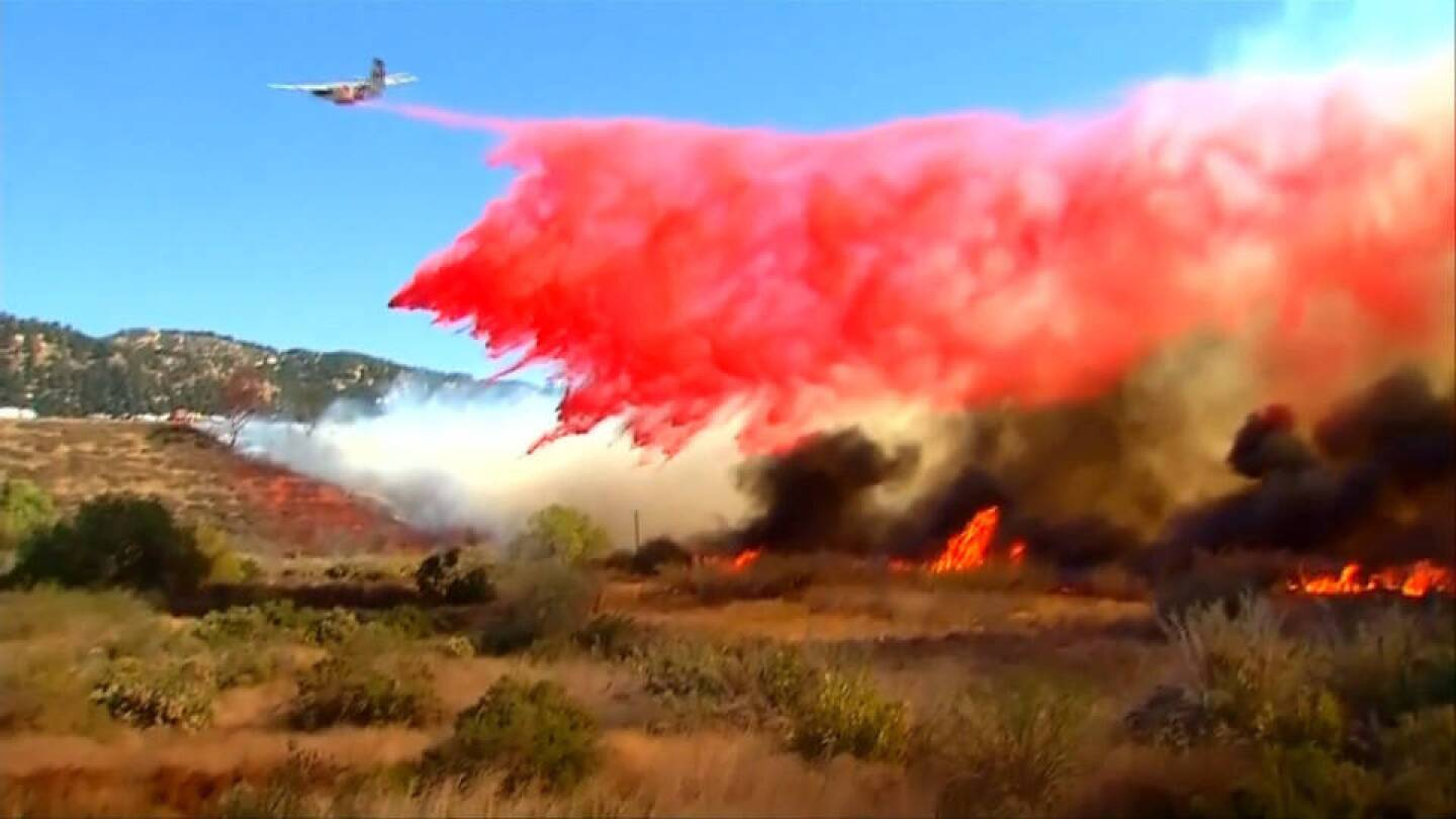Firefighting plane dropping fire retardant on wildfire in California. | Democracy Now