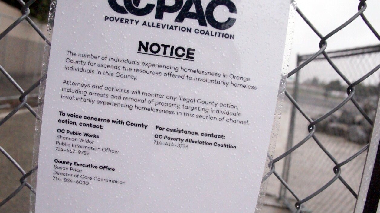 Sign to inform homeless people being evicted from the Santa Ana River banks about the services of the OC Poverty Alliance Coalition