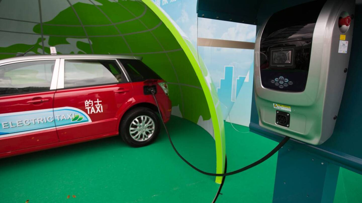 ARCHIVE PHOTO: A BYD E6 electric car is seen plugged into a charging unit during a launch ceremony for the line vehicles in Hong Kong, May 15, 2013. | REUTERS/Tyrone  Siu