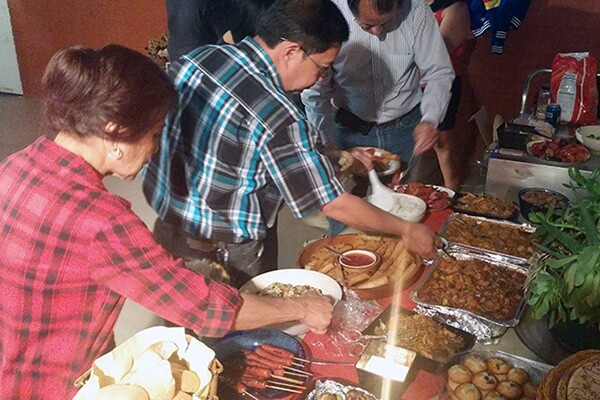 A table full of mostly Filipino dishes is a mainstay at Pacquiao fight night parties. | Photo: Elson Trinidad