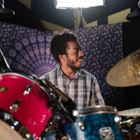 """Mekala Session playing drums with a purple background   Samantha Lee """"The New West Coast Sound: An L.A. Jazz Legacy"""" ab s11 episode image"""