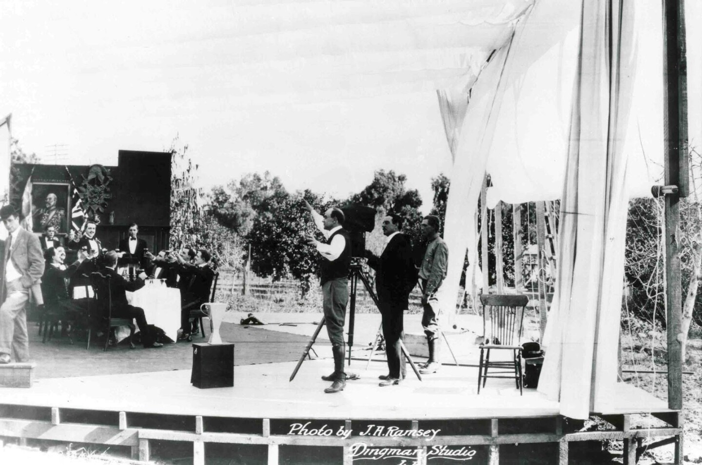 """Director Cecil B. De Mille directs """"The Squaw Man"""" on an open-air set surrounded by lemon trees on the film's first day of shooting"""