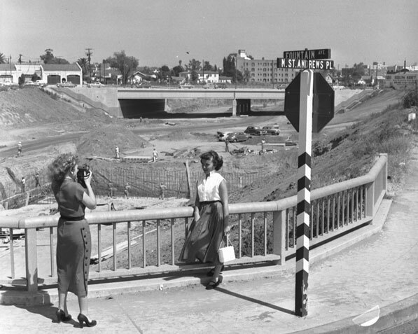 A woman poses in front of the uncompleted Hollywood Freeway, 1952. Courtesy of the Automobile Club of Southern California Collection.