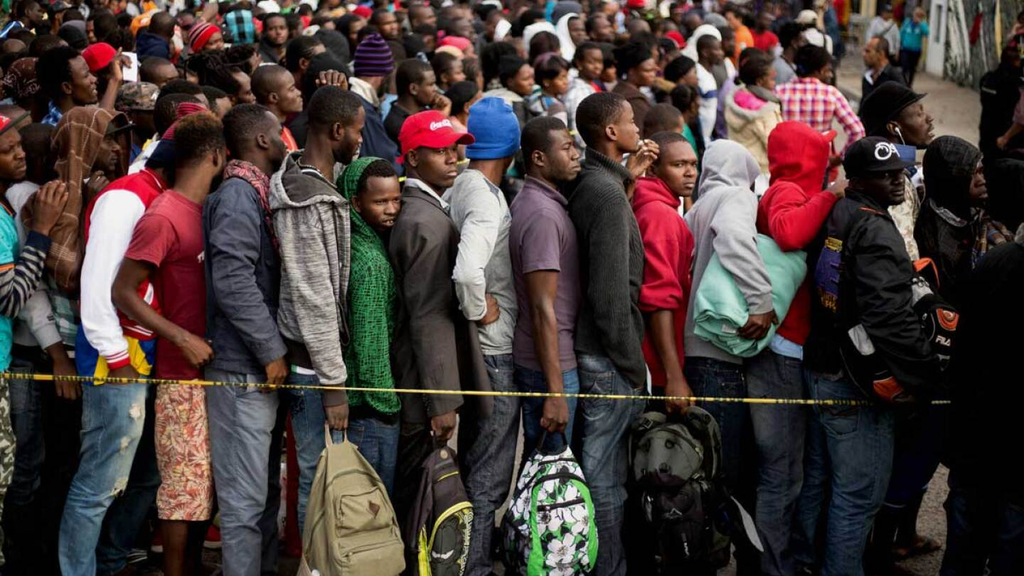 Haitian migrants waiting in a Tijuana, Mexico line. | GUILLERMO ARIAS/AFP/Getty Images