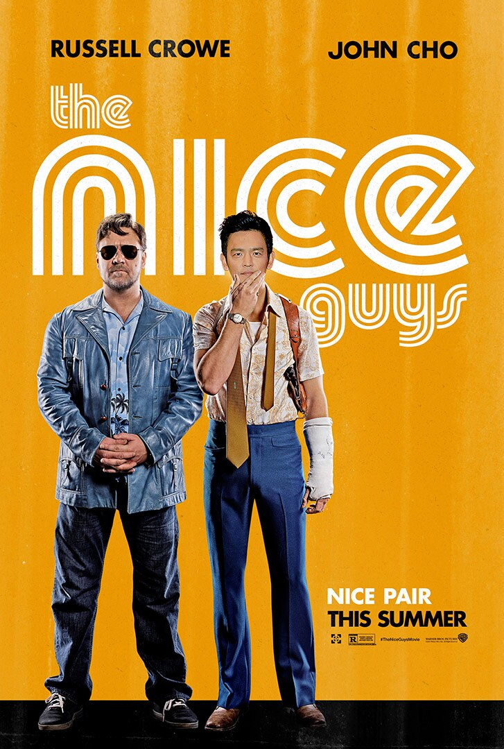 Movie poster featuring two men standing next to each other, one White and one Asian American, both in 1970s clothing.