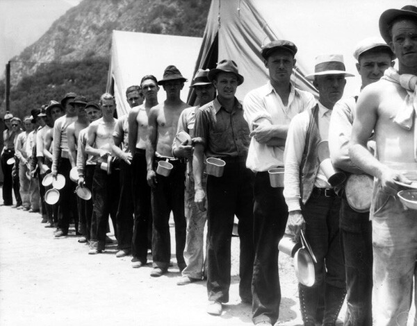 Numerous young men stand in a long line in the San Gabriel Mountains. | Photo Courtesy of the Los Angeles Public Library