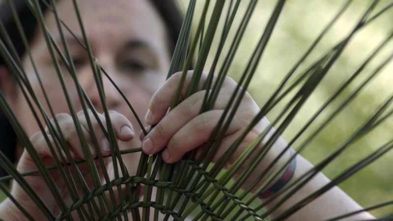 Tima Weaving a Basket