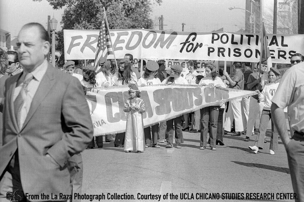 CSRC_LaRaza_B13F11S2_N007 Gusanos anti-communist demonstrators carry banners in Los Angeles | Pedro Arias, La Raza photograph collection. Courtesy of UCLA Chicano Studies Research Center