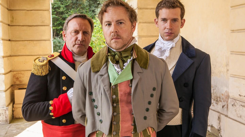 Three men in colonial attire look on.