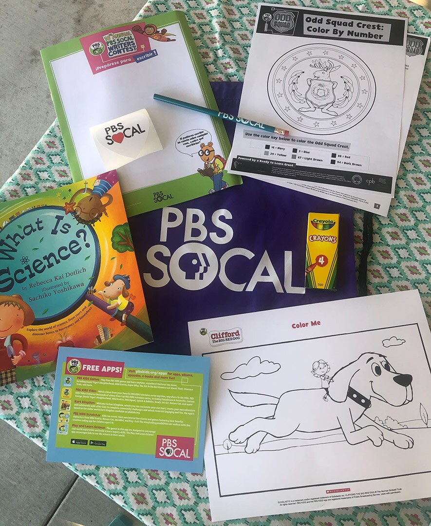 Children's activity pages and crayons are lay scattered on a table.