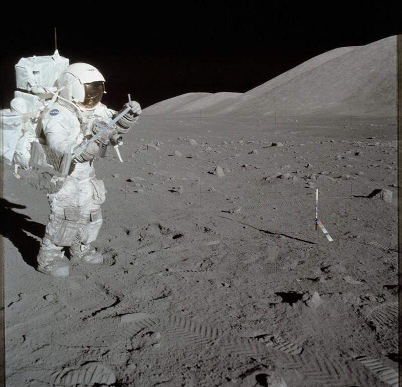 Astronaut Harrison Schmitt collects lunar rake samples during Apollo 17. | PICRYL/NASA/Public Domain Dedication (CC0)