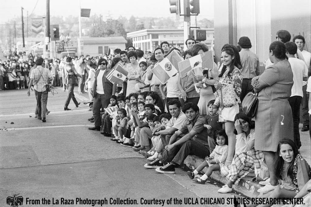 CSRC_LaRaza_B4F3C1_Staff_018 People watch the National Chicano Moratorium march to Laguna Park | La Raza photograph collection. Courtesy of UCLA Chicano Studies Research Center